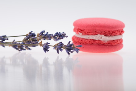 Pink Macaroons and lavender isolated on white