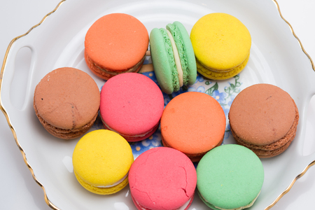 Colored Macaroons ona  porcelain  plate Stock Photo
