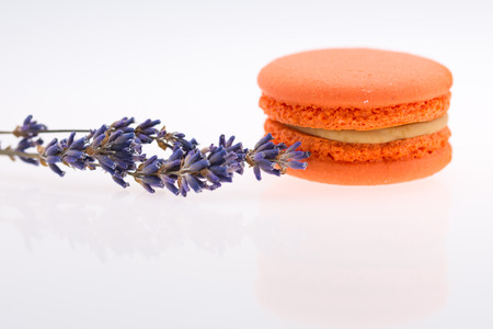 Orange  Macaroons and lavender isolated on white Stock Photo
