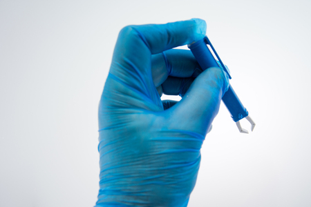 Blue Extractor for removing ticks,TICK TWISTER in a hand