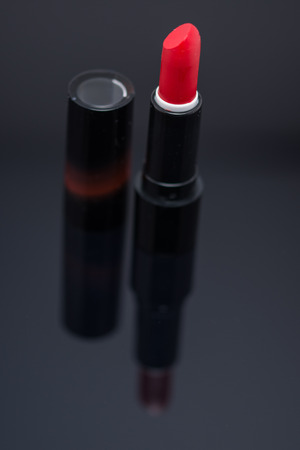 Shiny new red or scarlet lipstick over black