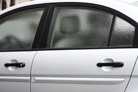 Freezing rain ice coated car.  Frozen  door car handle Banque d'images - 97870531