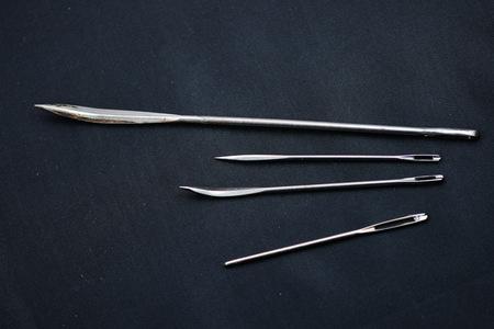 Assorted Hand Sewing Needles on black background 版權商用圖片