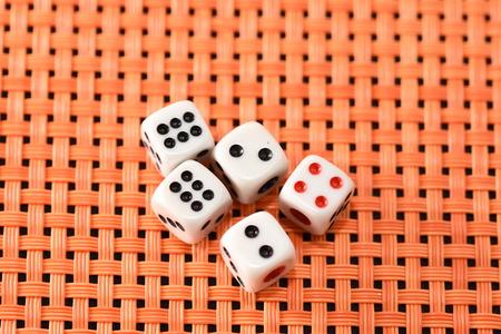 dices on orange background