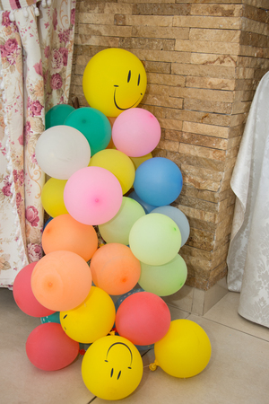 bunch of multi-coloured balloons at party