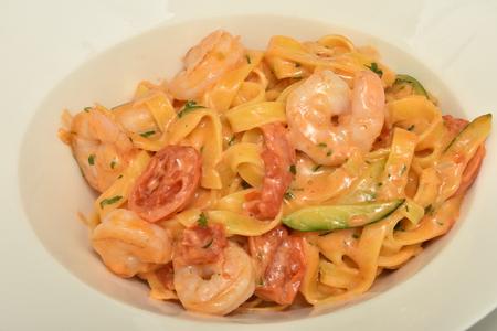 Pasta with cream and Fresh shrimps Фото со стока