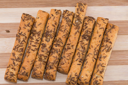 Crackers, cookies with cheese and caraway seeds