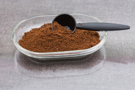 Ground coffee in glass bowl