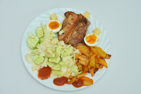 Traditional Romanian food, potato salad with barbecue