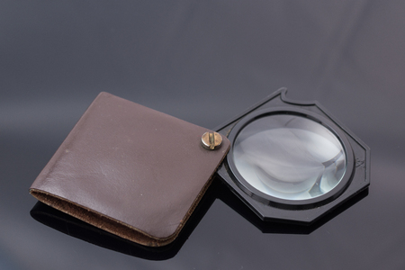 3X eye loupe, vintage pocket magnifying glass in a leather case