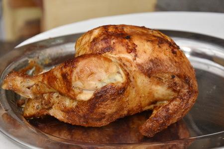 roasted chicken un silver tray