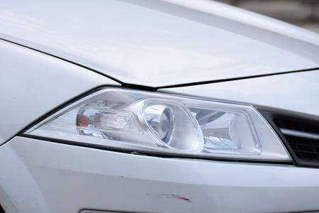 shiny headlight on a  white car
