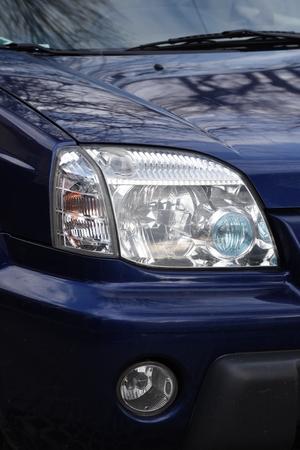headlight on a blue car Фото со стока