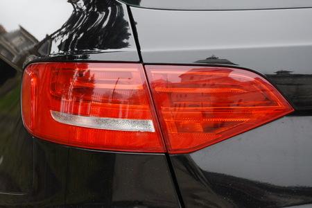 shiny headlight on a black car Фото со стока