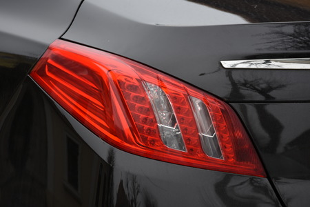 shiny headlight on a black   car