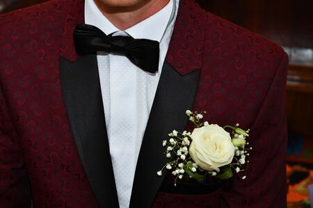 Groom with black bow tie.
