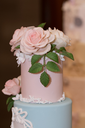 wedding cake decorated with  roses,flowers