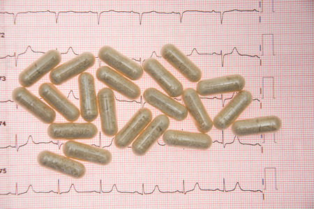 Heart Pill tablets  and electrocardiograms, Heartbeat
