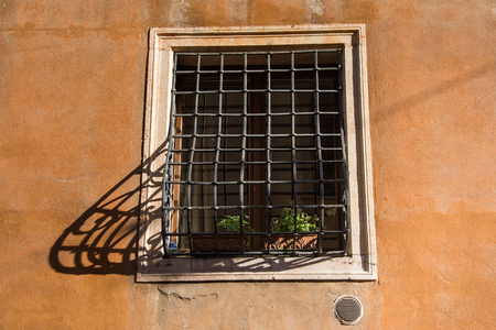 window with grates in venice,shadow bars,Italy,2019 Stock Photo