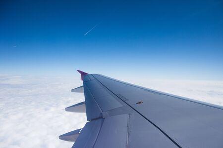An airplane window view of wing and flaps Zdjęcie Seryjne