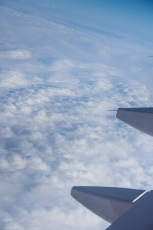 An airplane window view of wing and flaps