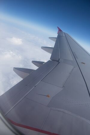 An airplane window view of wing and flaps 写真素材 - 125181261
