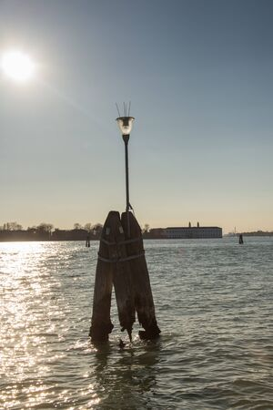 Wooden bricole ,wooden mooring poles in the water,  Venice, Italy,2019 스톡 콘텐츠