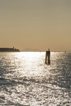 Wooden bricole ,wooden mooring poles in the water,  Venice, Italy,2019 스톡 콘텐츠 - 149182906