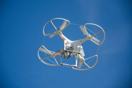 White drone flying over the city Reklamní fotografie