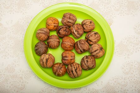 Nuts on a green plate