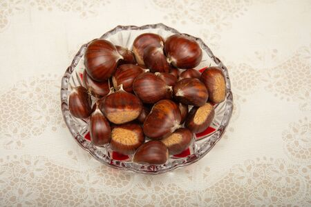 A small pile of chestnuts, conkers