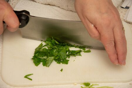 Cutting parsley in the kitchen