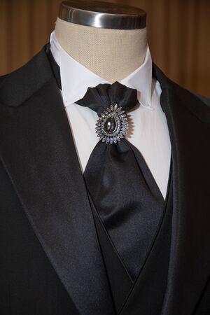 brooch on a black tie 写真素材