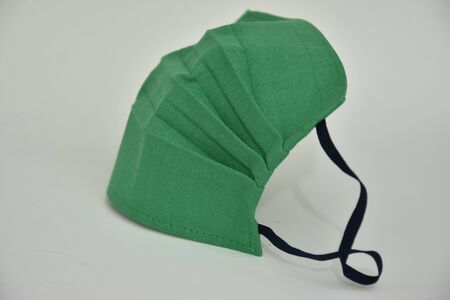 protective mask ,Homemade green face Mask -Coronavirus COVID-19) on white background