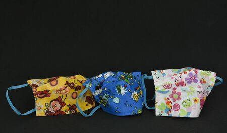 Homemade  masks ,three colored face masks from cotton for children,   -Coronavirus COVID-19) 写真素材