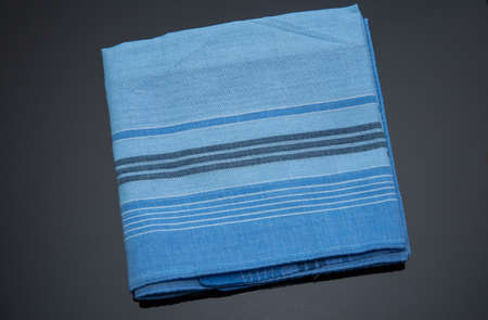 blue handkerchief with lines on the black background Imagens