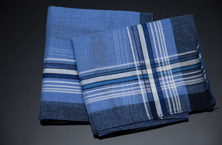 blue handkerchief with  lines on the black  background