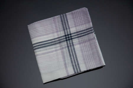 wite handkerchief with lines on the black  background