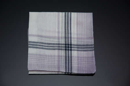 handkerchief with brown  lines on the black  background