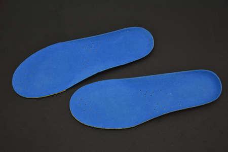 blue  Memory Foam  Shoe Insoles on a black background Stock Photo