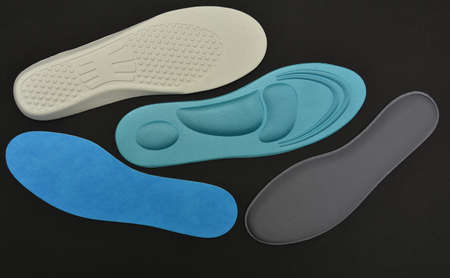 4 Memory Foam  Shoe Insoles on a black background