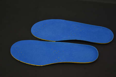 blue Memory Foam  Shoe Insoles on a black background