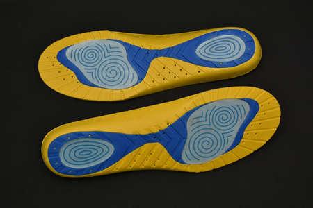 New orthopedic  Shoe Insoles on black  background