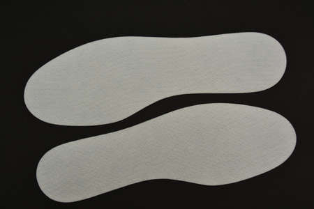 New white insoles dorsal part  on a black background Stock Photo