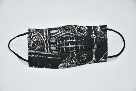black cotton mask with historical motifs