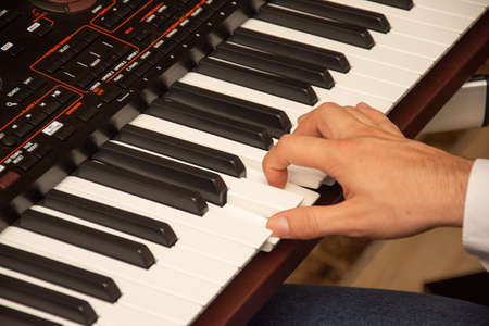 Closeup of man's hands playing piano Standard-Bild