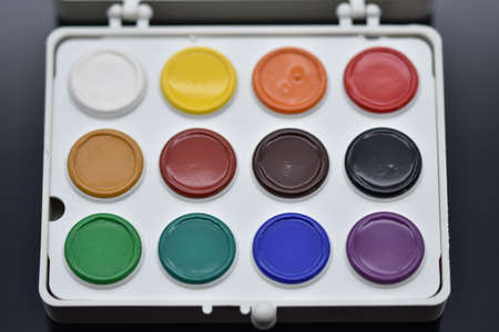 watercolor paints isolated on a black background.