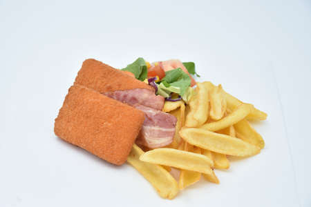 menu with french fries, chicken breast, tomatoes, corn and bacon