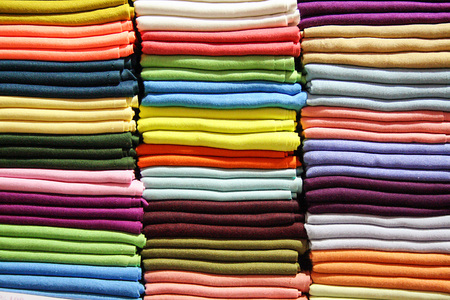 scarves: piles of multi-colored wool scarves