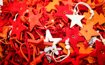 many soft tree decorations in the shape of stars in a christmas market
